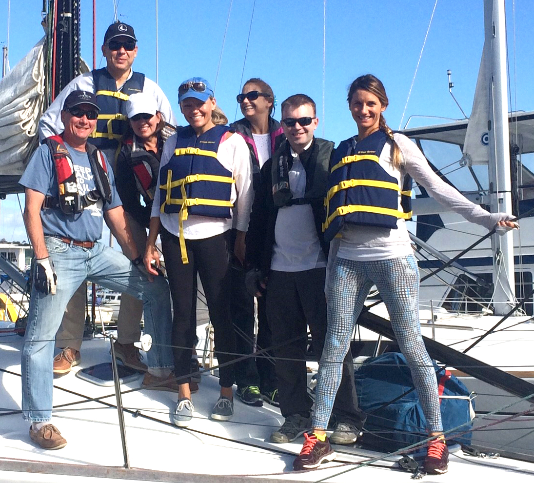 The Performance Race Team poses for a photo on the bow of Allegro before leaving the docks to go racing on San Francisco Bay.